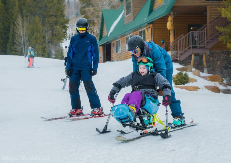 photo of youth in bi-ski