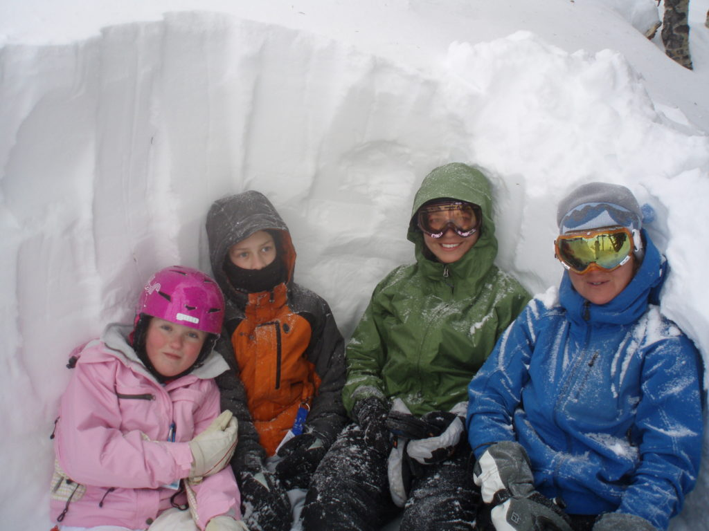 Participants in a snow pit
