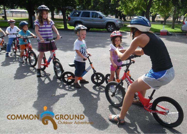 photo of kids riding balance bikes